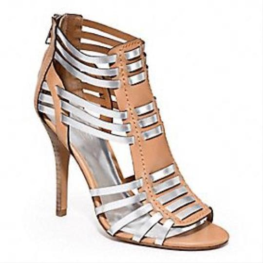 Preload https://item2.tradesy.com/images/coach-tan-and-silver-lucy-gladiator-heel-pumps-size-us-7-regular-m-b-23102216-0-0.jpg?width=440&height=440