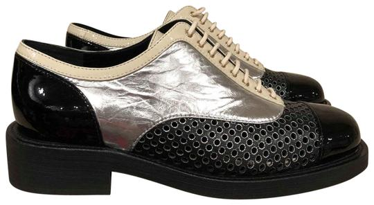 Preload https://item5.tradesy.com/images/chanel-black-white-silver-perforated-cc-mule-loafer-moccasin-oxford-flats-size-eu-38-approx-us-8-reg-23102909-0-1.jpg?width=440&height=440