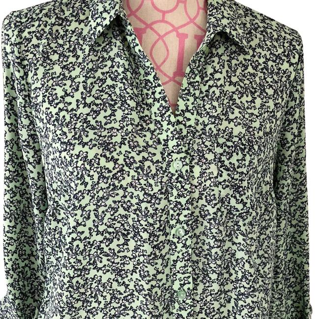 Preload https://item2.tradesy.com/images/the-limited-mint-navy-flower-print-rn54874-button-down-top-size-8-m-23102946-0-1.jpg?width=400&height=650