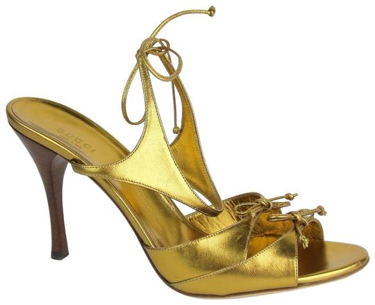 Preload https://item4.tradesy.com/images/gucci-purple-gold-metallic-leather-heel-wstring-ties-154297-2631-sandals-size-eu-395-approx-us-95-re-23103078-0-1.jpg?width=440&height=440