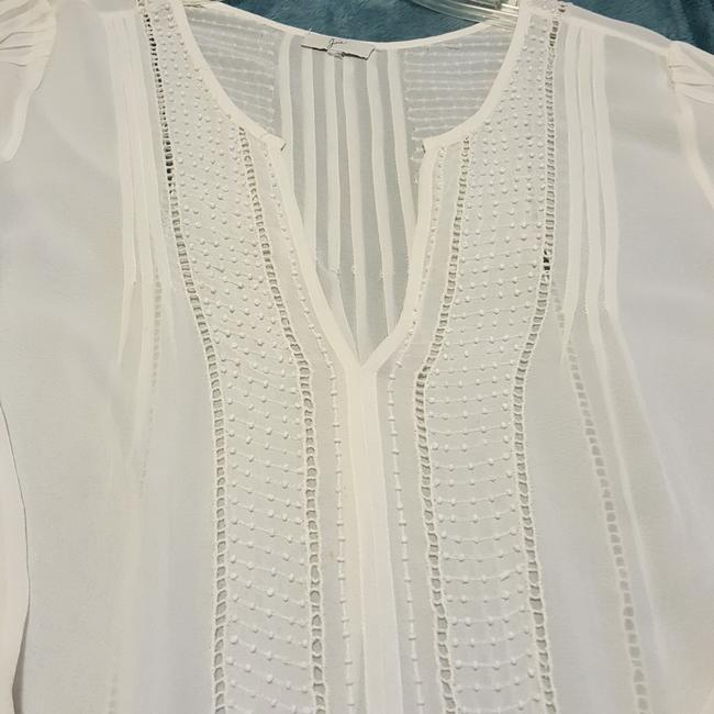 Preload https://img-static.tradesy.com/item/23103746/joie-sheer-off-white-silk-with-small-beading-blouse-size-12-l-0-1-650-650.jpg