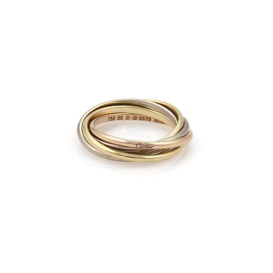 Preload https://img-static.tradesy.com/item/23103851/cartier-trinity-18k-gold-15mm-5-rolling-band-size-50-us-5-wcert-ring-0-0-540-540.jpg