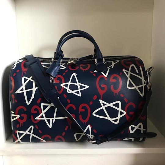 Preload https://img-static.tradesy.com/item/23104425/gucci-guccighost-duffel-navy-leather-weekendtravel-bag-0-0-540-540.jpg