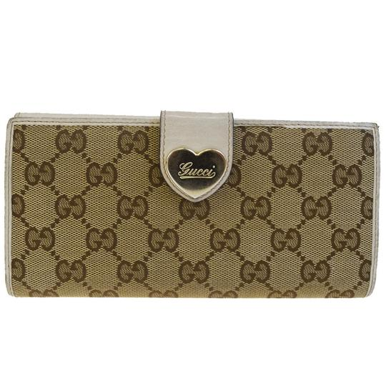 Preload https://img-static.tradesy.com/item/23105459/gucci-brown-gg-pattern-heart-long-bifold-purse-canavs-leather-wallet-0-0-540-540.jpg