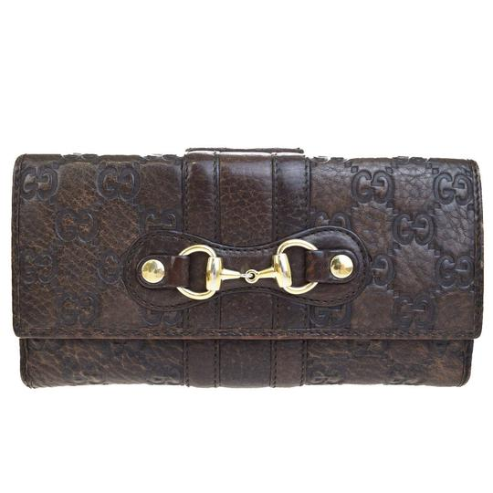 Preload https://img-static.tradesy.com/item/23105519/gucci-brown-gg-pattern-long-bifold-purse-leather-italy-wallet-0-0-540-540.jpg