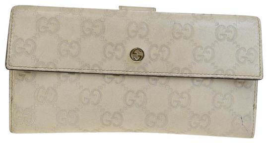 Preload https://img-static.tradesy.com/item/23105712/gucci-ivory-gg-pattern-long-bifold-purse-leather-italy-wallet-0-2-540-540.jpg