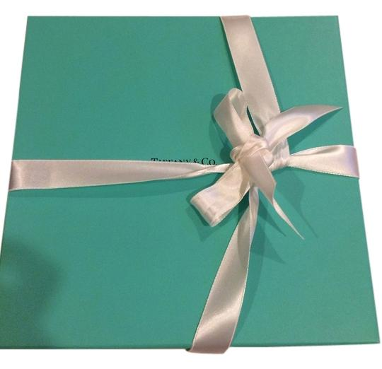 Preload https://item5.tradesy.com/images/tiffany-and-co-blue-gift-box-with-wraps-and-ribbon-2310584-0-0.jpg?width=440&height=440