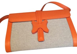 Made I Italy Orange leather and beige linen Clutch