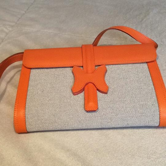Made I Italy Orange leather and beige linen Clutch Image 1