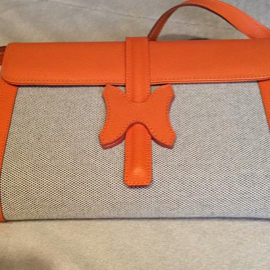 Made I Italy Orange leather and beige linen Clutch Image 2