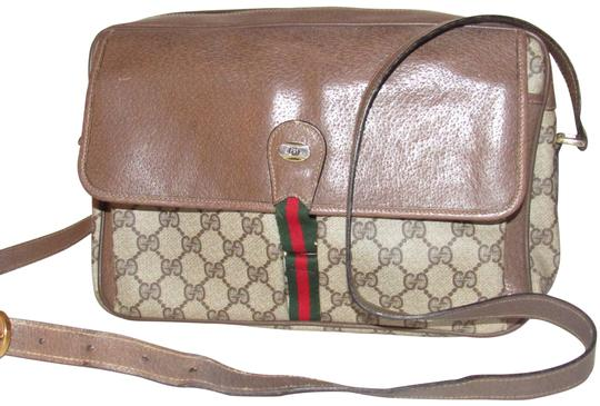 Preload https://img-static.tradesy.com/item/23126838/gucci-1985-accessory-collection-school-bag-shades-of-brown-with-large-g-logo-and-redgreen-striped-ac-0-1-540-540.jpg