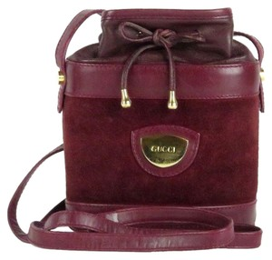 Gucci Shoulder/Cross Body Drawstring Top Mint Vintage Rare Early Color' Satchel in burgundy leather and burgundy suede with gold hardware