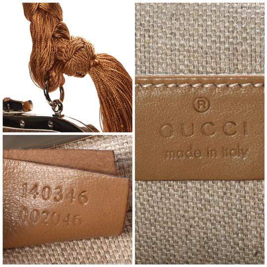 Gucci golden or camel Clutch
