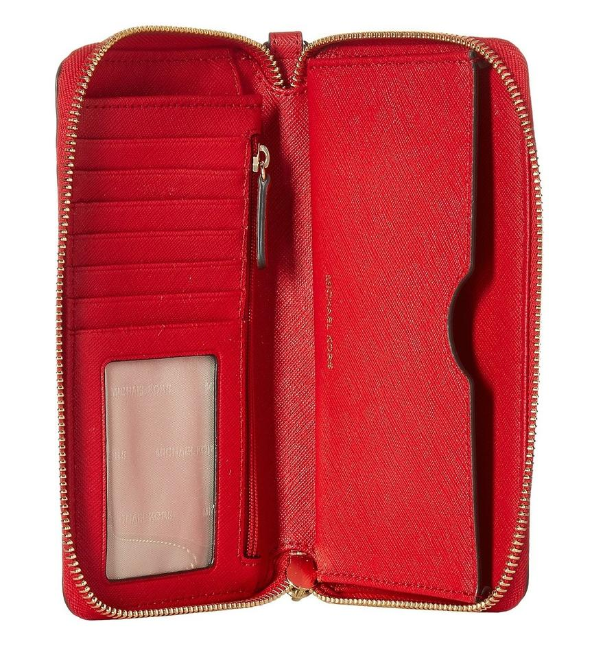 c91a7d49f7a5 Michael Kors Jet Set Travel Large Flat Phone Multifunction Wallet Saffiano  Wristlet in Bright Red Image. 12345