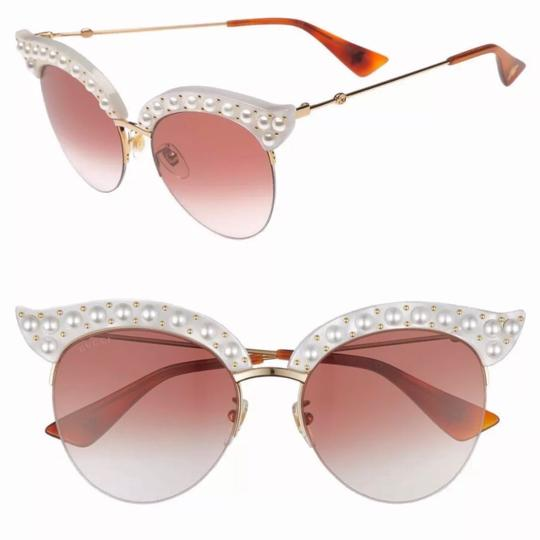 Preload https://img-static.tradesy.com/item/23167821/gucci-white-faux-pearl-cat-eyes-sunglasses-0-0-540-540.jpg