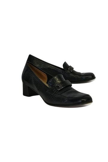 Preload https://img-static.tradesy.com/item/23175044/salvatore-ferragamo-black-pumps-size-us-75-regular-m-b-0-0-540-540.jpg