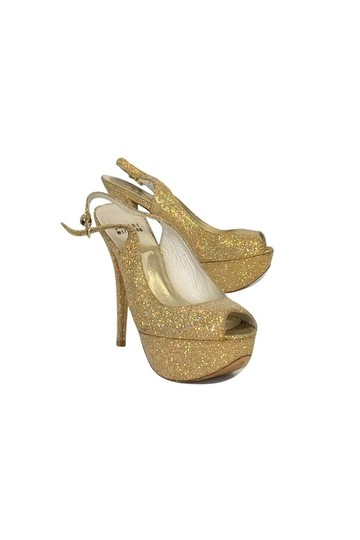 Preload https://img-static.tradesy.com/item/23175082/stuart-weitzman-gold-pumps-size-us-55-regular-m-b-0-0-540-540.jpg