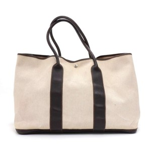 11289785fd56 Added to Shopping Bag. Hermès Leather Canvas Handbag Tote in Beige. Hermès  Garden Party Gm Chocolate Brown ...