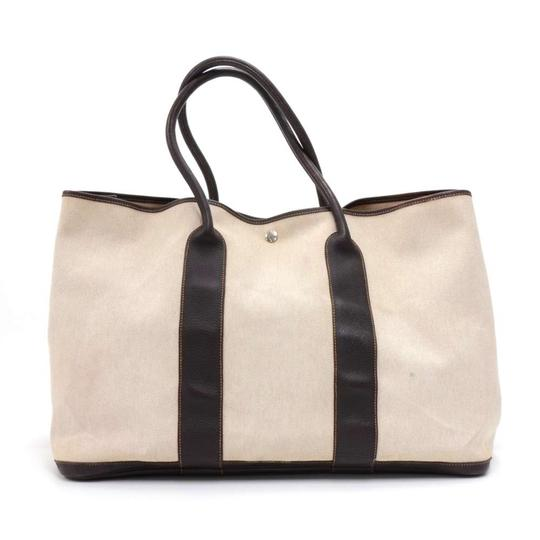 Preload https://img-static.tradesy.com/item/23178895/hermes-garden-party-gm-chocolate-brown-leather-hand-beige-canvas-tote-0-0-540-540.jpg