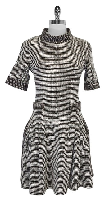 Preload https://img-static.tradesy.com/item/2318000/chanel-brown-tweed-wool-and-cotton-blend-pleated-mid-length-short-casual-dress-size-6-s-0-0-650-650.jpg