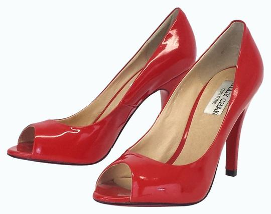 Preload https://img-static.tradesy.com/item/2318159/-red-patent-leather-peep-pumps-size-us-65-0-0-540-540.jpg