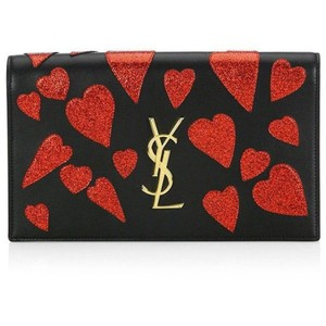 0cc54360e7 Saint Laurent Monogram Clutches - Up to 70% off at Tradesy