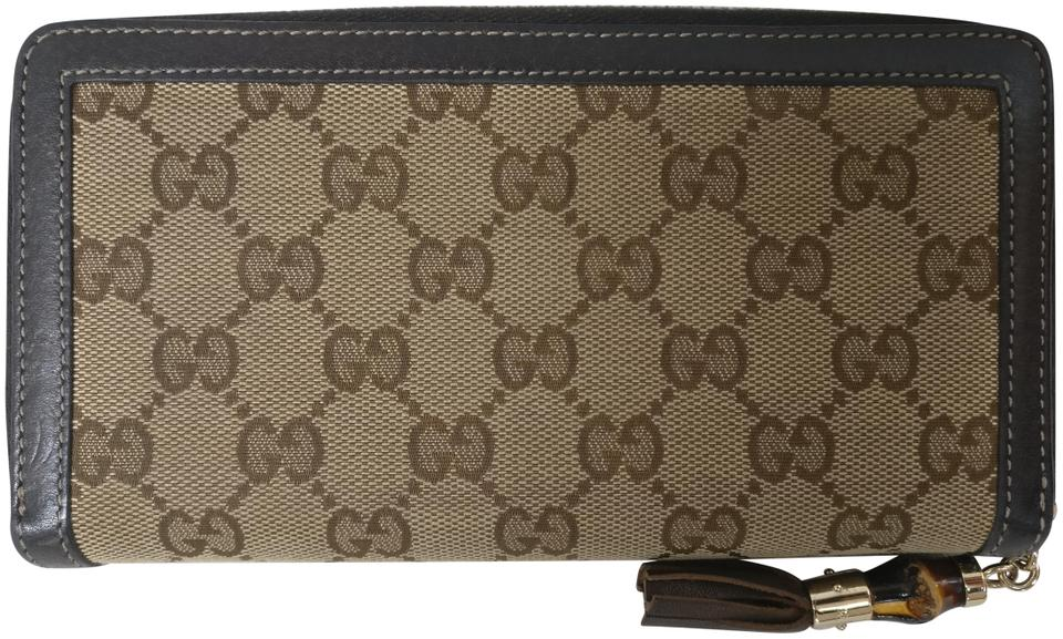 74bbf5f1189b Gucci Gucci Gg Monogram Bamboo Tassel Canvas Leather Zip Around Wallet  Image 0 ...