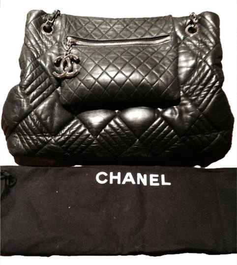 Preload https://item5.tradesy.com/images/chanel-in-and-out-tote-black-lamb-skin-shoulder-bag-2318384-0-0.jpg?width=440&height=440