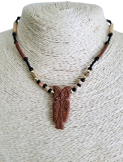 Preload https://img-static.tradesy.com/item/23184792/brown-black-ivory-gold-beaded-owl-choker-necklace-0-1-540-540.jpg
