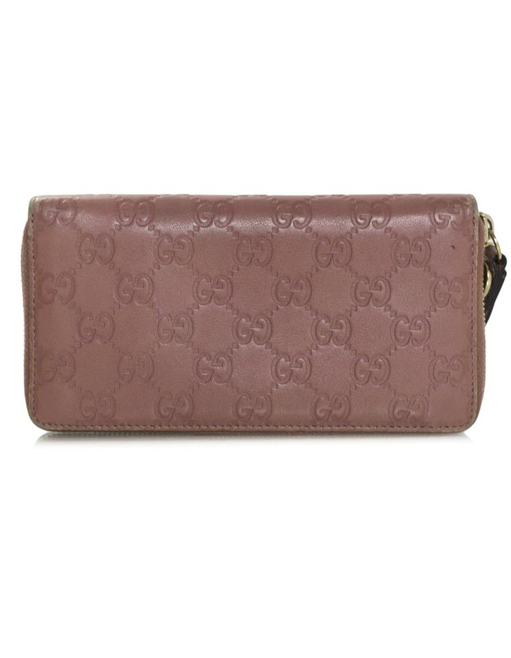 1b249b31f022 Gucci Gucci Pink Embossed Monogram Leather Zip Around Wristlet Wallet Image  8. 123456789