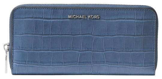 Preload https://img-static.tradesy.com/item/23198706/michael-kors-denim-blue-jet-set-travel-crocs-leather-continental-wallet-0-1-540-540.jpg