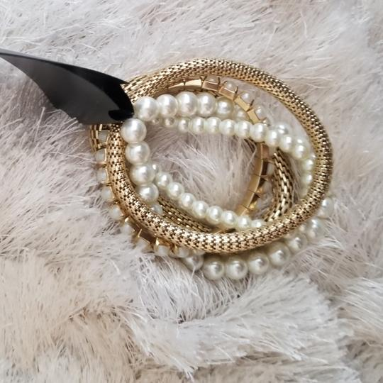 Primark Faux gold and pearl bracelets Image 1