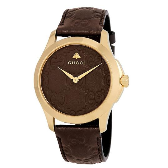 Preload https://img-static.tradesy.com/item/23209464/gucci-gold-brown-g-timeless-leather-strap-gg-dial-men-s-dress-style-watch-0-0-540-540.jpg