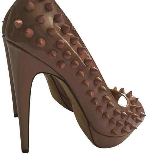 Preload https://img-static.tradesy.com/item/23211013/diba-nude-peep-toe-spikes-pumps-size-us-8-regular-m-b-0-1-540-540.jpg