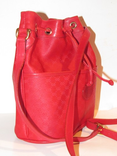 Gucci Drawstring Top Bucket Style Mint Vintage Rare Color Satchel in red small G logo print coated canvas and red leather