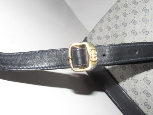 Gucci Shoulder/Cross Body Drawstring Top Mint Vintage Rare Early Bucket Satchel in navy blue leather and blue small G print coated canvas