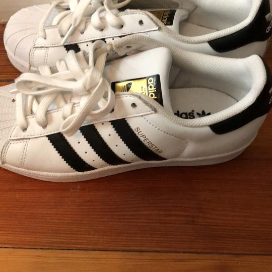 adidas black and with a gold logo Athletic