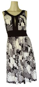 London Times short dress Brown Slinky Sleeveless Print on Tradesy