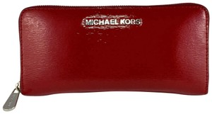 f1025948147a Red Michael Kors Wallets - Up to 70% off at Tradesy