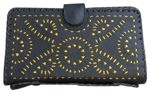 Cleobella black and gold Clutch