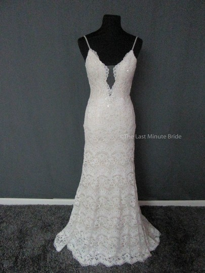 Preload https://img-static.tradesy.com/item/23242440/maggie-sottero-ivoryltgold-lace-mietra-6mt843-feminine-wedding-dress-size-6-s-0-0-540-540.jpg