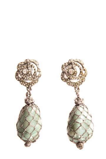 Preload https://item1.tradesy.com/images/dior-silver-silver-tone-clip-on-crystal-detail-designerchristian-earrings-23242610-0-0.jpg?width=440&height=440