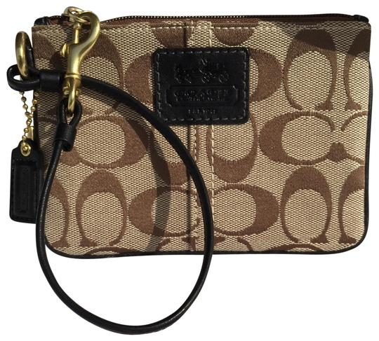 Preload https://img-static.tradesy.com/item/23242689/coach-tan-and-dark-brown-signature-skinny-wristlet-wallet-0-1-540-540.jpg