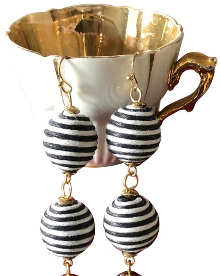 Preload https://item2.tradesy.com/images/black-and-white-gold-tone-striped-cord-earrings-23242871-0-3.jpg?width=440&height=440