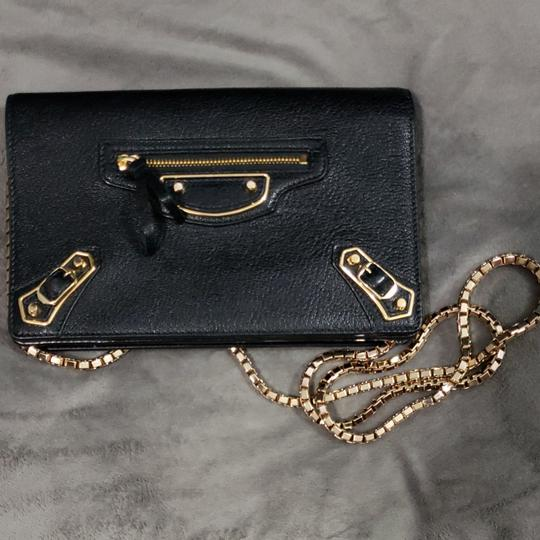 Preload https://img-static.tradesy.com/item/23243276/balenciaga-metallic-edge-wallet-on-chain-black-leather-cross-body-bag-0-0-540-540.jpg