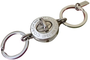 Coach coach white turn lock keychain