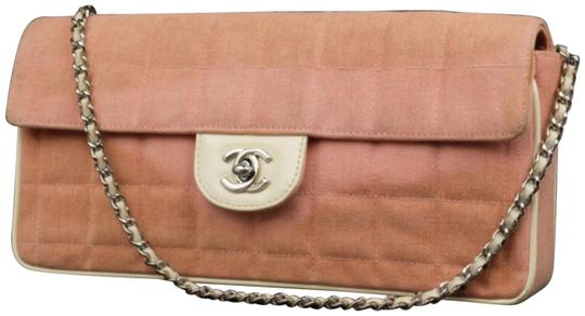Preload https://img-static.tradesy.com/item/23244311/chanel-east-west-quilted-denim-flap-227479-pink-coated-canvas-cross-body-bag-0-1-540-540.jpg