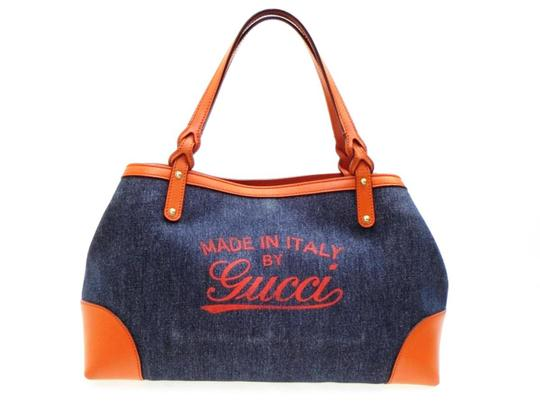 Preload https://img-static.tradesy.com/item/23244347/gucci-denim-shopper-tote-227560-orange-coated-canvas-shoulder-bag-0-0-540-540.jpg