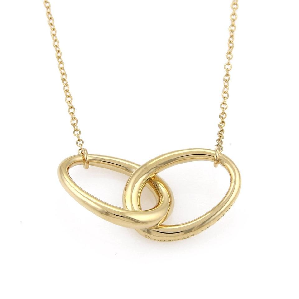 Tiffany co peretti 18k yellow gold double oval ring pendant peretti 18k yellow gold double oval ring pendant necklace mozeypictures Choice Image