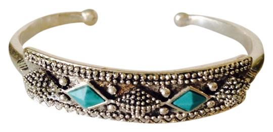 Preload https://img-static.tradesy.com/item/2326071/lucky-brand-silverblue-nwot-tribal-style-turquoise-stone-cuff-bracelet-0-0-540-540.jpg